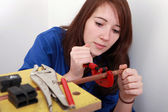 Red-haired girl working as plumber — Stock Photo