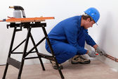 Laborer with screwdriver and blowtorch — Stock Photo