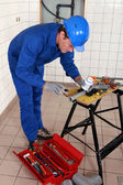 Experienced plumber at work with miscellaneous tools — Stock Photo