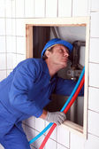 Plumber installing hot and cold water pipes — Stock Photo