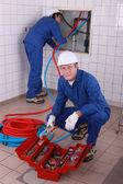 Trabajadores en la casa — Foto de Stock