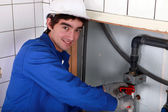 Junior plumber at work — Stock Photo