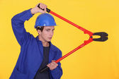 Young worker using a bolt cutter — Stock Photo
