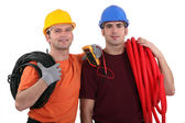 Two electricians with equipment — Foto Stock