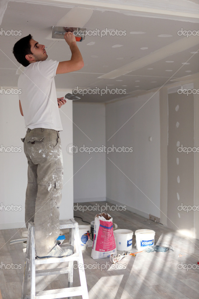 Craftsman painting the ceiling  Stock Photo #7691610