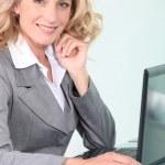 Businesswoman on laptop — Stock Photo