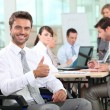 Stock Photo: Disabled businessmsmiling in office