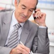 Senior businessman with cellphone — Stock Photo