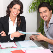 Stock Photo: Businesspeople signing contract