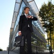 Young executive waiting outside a modern building — Stock Photo
