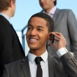 Young businessman talking on his mobile phone — Stock Photo