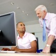 Computer specialist and his boss — Stock Photo