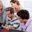 Group of sitting round a computer — Stock Photo #7705101