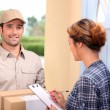 Man delivering pallet - Stock Photo