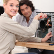 Female technician repairing a computer — Stock Photo