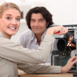 Happy technician fixing a computer — Stock Photo #7705666