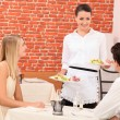 Waitress serving couple — Stock Photo