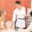 Couple interacting with waitress at a dinner — Stock Photo