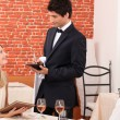 A dressy couple ordering in a chic restaurant - Stock Photo