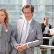 Stock Photo: Male and female executives outside conference center