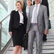 Business walking down steps — Stock Photo