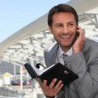 Stock Photo: Businessmon phone with diary