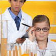 Children analysing orange juice — Stock Photo #7707926