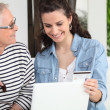 Mother and daughter shopping online — Stock Photo #7708261
