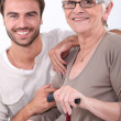Portrait of young man and older woman — Stock Photo
