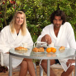 Stock Photo: Couple eating breakfast on terrace