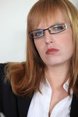 Zencefil saçlı ofis çalışanı — Stok fotoğraf