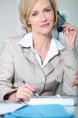 Woman holding headset. — Stock Photo