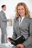 Businesswoman checking diary — Stock Photo