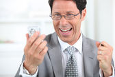 Businessman on the phone laughing — Stock Photo