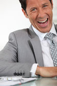 Office manager laughing — Stock Photo