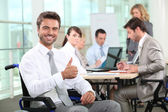 Disabled businessman smiling in office — Stock Photo