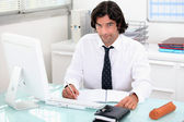 Man working at his desk — Stock Photo