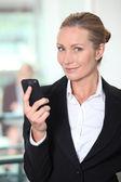 Mature woman using smartphone — Stock Photo