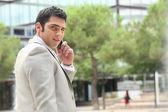 Businessman on mobile phone — Stock Photo