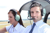 Man and woman in the cockpit of a light aircraft — Stock Photo