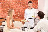 Waitress serving couple — Stock Photo