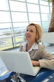 Businesswoman on laptop — Stock Photo