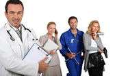 MD , mechanic, doctor and secretary. — Stock Photo