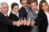 Manager and his team all giving a strong thumbs up — Stock Photo