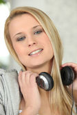 Blond woman listening to music — Stock Photo