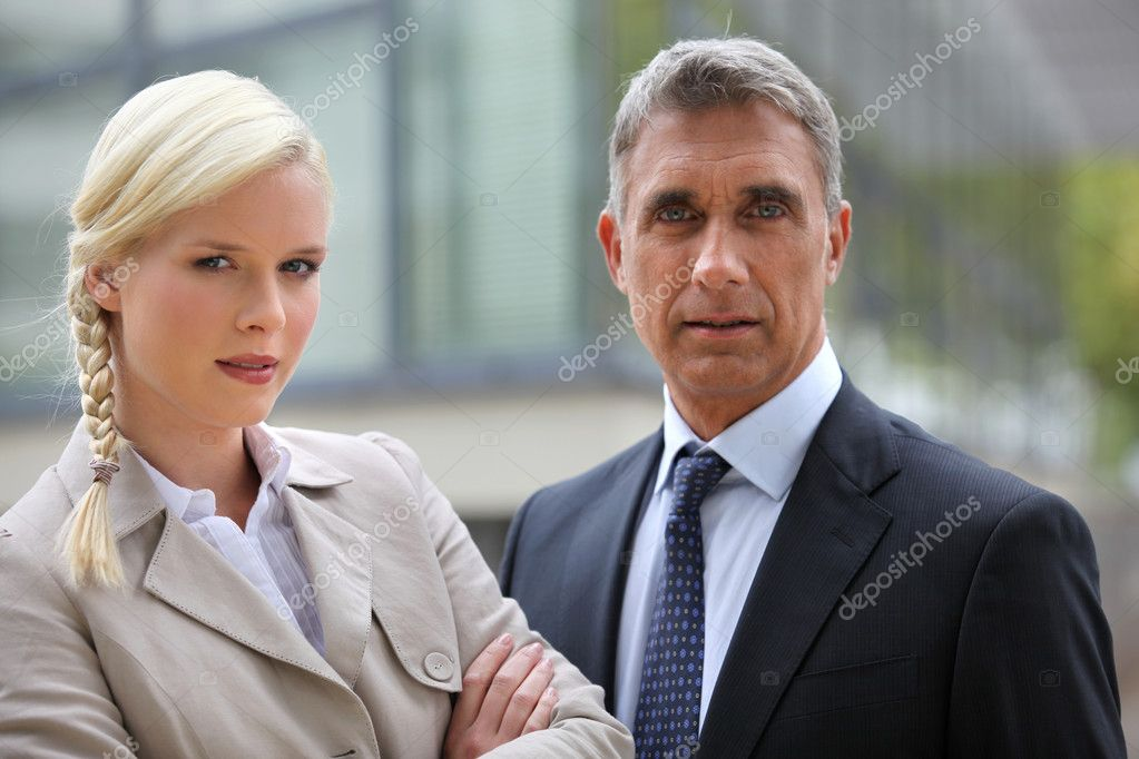 Young woman and director looking preoccupied  Stock Photo #7704483
