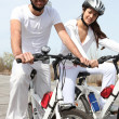 Royalty-Free Stock Photo: Young couple on bicycle