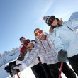 Four friends skiing — Stock Photo