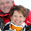 Elderly couple skiing — Stock Photo #7710230
