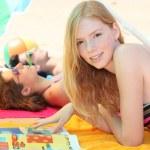 Three teenagers sunbathing together — Stock Photo